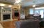 New wood flooring, gas fireplace, crown molding, built-ins and more.