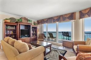 Living area with tiled flooring and amazing gulf views.