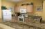 Featuring breakfast bar and granite counter tops