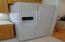 Side by side fridge with ice maker in the door will convey