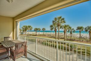 This elevated 1st floor 3 bedroom condo boasts amazing views of the Gulf with 60' of outdoor patio space.