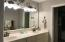 Double vanity, walk-in closet, separate shower.