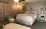 Large loft/bedroom with wall-to-wall closets.
