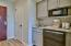 Renovated kitchenette with quartz countertop.