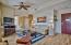 One-bedroom side also has wood-look tile flooring.