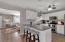 kitchen with tiled backsplash and breakfast bar
