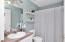 Guest Bathroom - Tiled - located between guest bedrooms