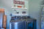 laundry in garage / washer and dryer convey