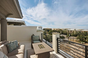 Wow, rooftop terrace with seating, partially covered, 2 seating areas, partial view of Gulf!