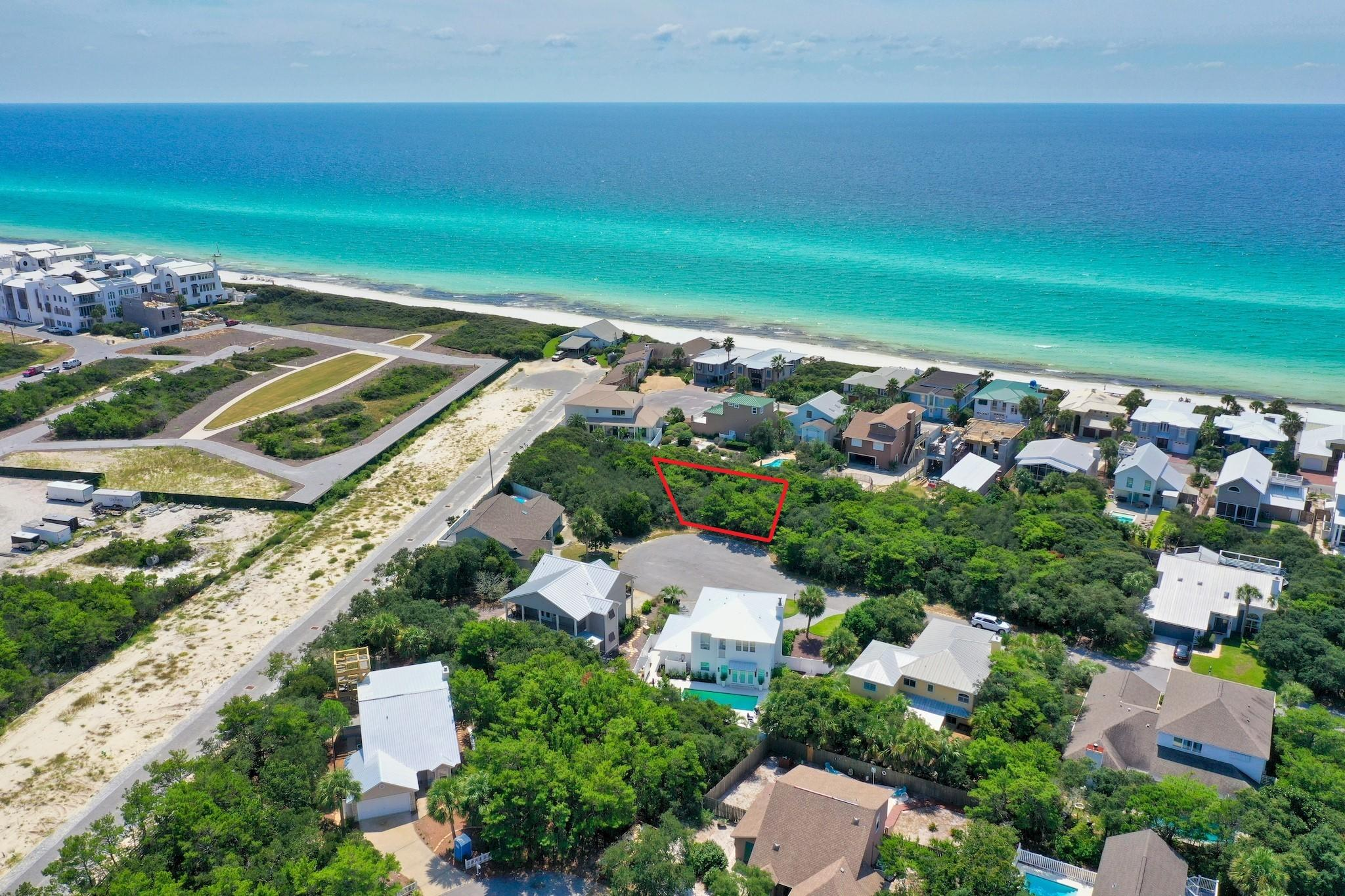 Amazing cul-de-sac lot in a private, non-rental gated Gulf front community of 30A. Sand Cliffs on the Gulf is an exclusive community bordering Alys Beach and the beautiful Gulf of Mexico. With low HOA fees and no build out time, this is the perfect opportunity to build your dream beach home! Gulf front lots are restricted from building higher than 18.5 ft, however Lot 12 can build up to 30 ft high which means you can still enjoy Gulf views from a higher floor! This large lot sits high and dry on the bluff, the perfect place to build your 2.5 story dream beach home with Gulf views & lush surroundings! Sand Cliffs features two deeded beach accesses offering 1300+ ft of pristine beach along the beautiful emerald green & crystal blue waters of the Gulf of Mexico. This is a prime lot location! You will be within 1/2 a mile of the beautiful white sand beaches and there is a walkway located on the same street just steps outside of your door that leads to the private beach boardwalk. Sand Cliffs on the Gulf offers a peaceful setting for private homeowners, with no thru traffic nor crowded beaches. Sand Cliffs is one of the highest elevations on the Gulf of Mexico along Scenic Hwy 30A. Lot 12 sits high on the bluff with miles of panoramic views, both west and east. Being south of 30A and nearby Alys and Rosemary Beach means you are just a short walk or bike ride away from all the attractions that the desired east end of 30A has to offer, yet you can relax and enjoy the privacy of being tucked away in a serene, non-rental, beachfront community. You are also very close to The Hub 30A which offers world class live music, family friendly movie night, sports on the big screen outdoors and great dining, galleries and shopping. Sand Cliffs on the Gulf is located amid Florida's finest beach communities, restaurants and recreational activities, so do not miss out on this incredible opportunity to have quick access to it all! Build your private oasis today.