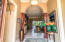 Arched foyer with columns and crown molding set the tone