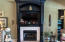 Gas fireplace w beautiful finishes and custom cabinetry for components