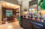 Perfect space for entertaining | notice the wall sconces over the bar