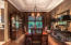 Elegant dining room with crown molding highlighting the trey ceilings