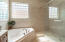 Separate glass walk in shower and jetted tub