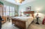 Guest bedroom with crown molding | fan w palm design