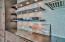 Custom floating shelves with lighting