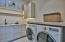 Large laundry room with great counter space and storage