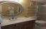 Master Bath is light and bright with updated mirror