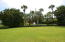 Expansive green area adjacent to the community pool for picnics, exercise, or sports.