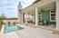 Huge wraparound patio with fireplace, pool and plenty of entertaining space