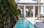 Water fountain feature in the pool and private courtyard of this stunning residence ~ 31 Governor's Court in Alys Beach