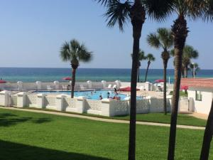 View from your porch over the pool to see the blue Gulf of Mexico and sandy white beaches