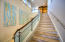 """Stairs leading to the """"Owner's Lounge, Fitness Room and Private heated Pool Area"""