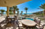 """Outdoor seating area off the """"Owner's Lounge"""" overlooking the private heated pool of Grand Dunes"""