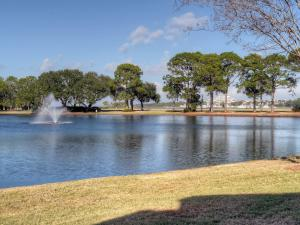 Enjoy the views of the lake with fountain and bay in the distance