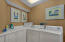Full size laundry room with storage