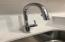 Super sleek, modern, Moen kitchen faucet with pull down sprayer. This is a picture of faucet only. Kitchen countertops will be granite.