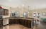 Large bar with granite countertops and plenty of cabinet storage