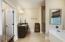 En suite master bathroom with dual closets and dual vanities