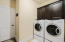 Laundry room with cabinets and plenty of storage-washer and dryer convey with the purchase.