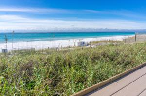 VIEW OF STERLING SHORES PRIVATE BEACH FROM THE SS OWNER BEACH CLUB VIEWING DECK & BEACH SIDE POOL.