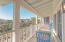 Spacious outdoor porch with access from masterbedroom and living area.