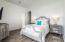 Master bedroom w/kingsize bed.