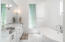 Master bath with double vanity, and separate garden tub