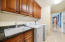 Look at the huge laundry Room, complete with built-in cabinetry, basin sink and granite surround