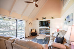 Vaulted Ceilings make this 2nd floor condo feel even larger ... beautiful natural lighting abounds