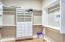 Large Walk-in Master Closet with builtin drawers and Shelving