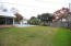 The large, flat yard is fully fenced with multiple gates!