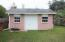 This yard building has electricity and is perfect for storing yard supplies and pool toys!