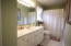 Full bathroom with large vanity is ideal for guests!