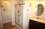 The master features a separate shower and tub as well as a private water closet!