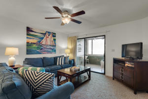 The Living area overlooks the patio, which offers beautiful views of the Bayou & Bay.