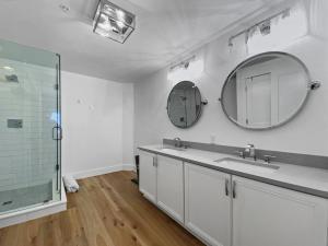 Beautifully done master bath. Quartz double vanity, custom shower, and new lighting