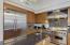Large kitchen with Viking Professional appliances large island.