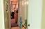 Looking towards downstairs bedroom, washer/dryer hook-up, full bath down
